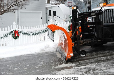 close up on snowplow removing snow in the street