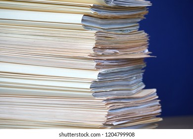 close up on the stacking documents and folders