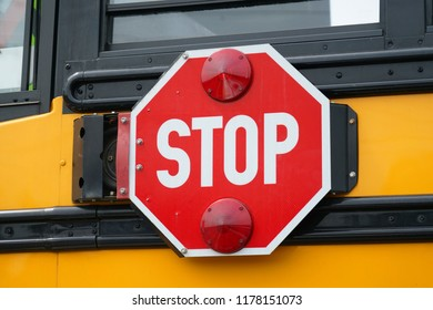 close up on stop sign on the school bus