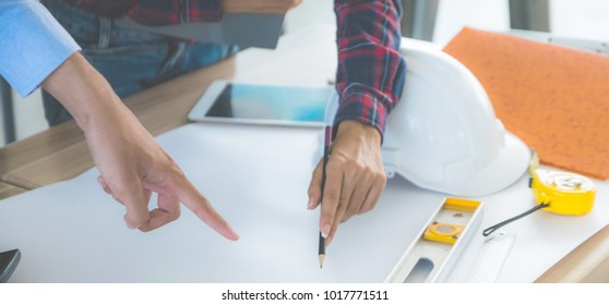 Close up on table architecture and engineering consult blueprint builder Background,Concept Business Success