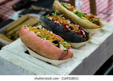 close up on three type of vegan hot dogs