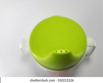 Close up on tip of Baby sippy cup isolated on white background