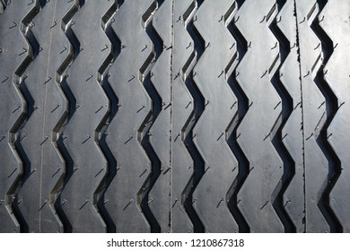 Close up on tracktor tire protector texture background.