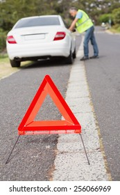Close up on triangle warning sign on the road