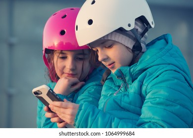 Close up on two girls looking at smartphone.