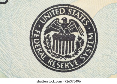 Close up on US dollar banknotes. U.S. Treasury Seal on US Dollar banknotes. Shooting by 1:1 Macro lense.