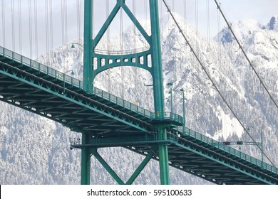 Close on Vancouver's iconic Lions Gate Bridge during the winter months/Winter Mountains and Lions Gate Bridge/Close on Vancouver's iconic Lions Gate Bridge during the winter months.