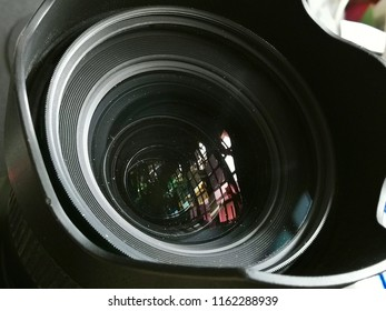 close up on a very dusty camera lens front element