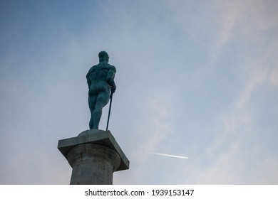 Close up on the Victor statue on Kalemegdan fortress, during a sunny sunset afternoon, seen from behind. Also called Viktor Pobednik, Located in Kalemegdan fortress, it's a landmark of the city.