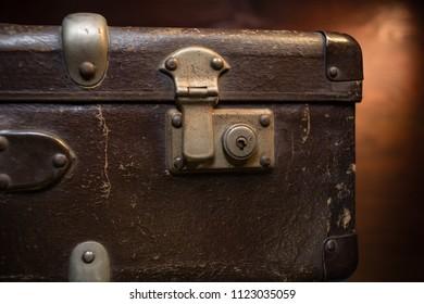 Close up on vintage brown suitcases lock.