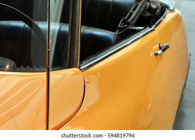 Close up on yellow elegant convertible car