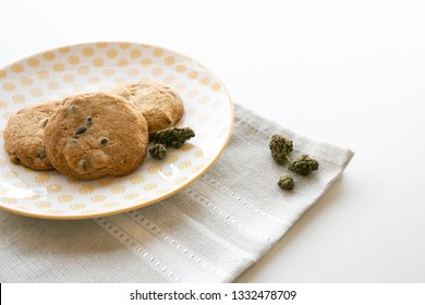 Close up on a Yellow Patterned Plate with Chocolate Chip Cookies with Cannabis Buds