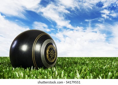Close up of one bowling ball on an open bowling field