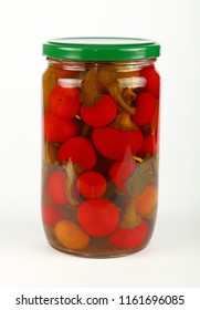 Close up of one glass jar of pickled small round red hot cherry chili peppers over white background, low angle view