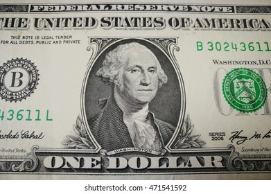 Close up of one US dollar bank note with image of Washington. US money background.