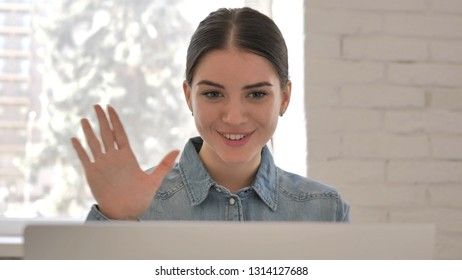 Close Up of Online Video Chat on Laptop by Young Girl