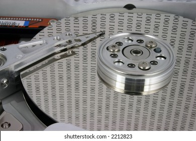 Close up of an open hard disk with binary numbers on the platter