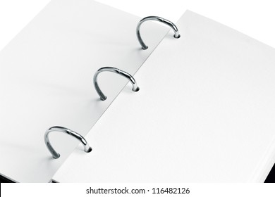 close up of open notebook with blank pages