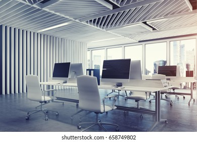 Close up of an open space office interior with gray wooden walls, concrete floor and two rows of computer tables along a wall and a panoramic window. 3d rendering mock up