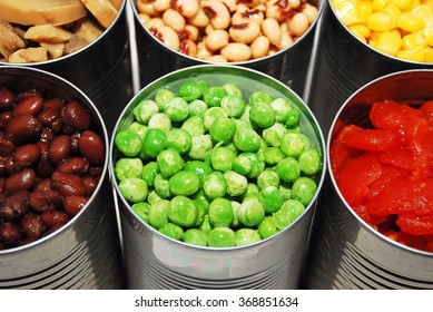 Close up of opened cans of vegetables