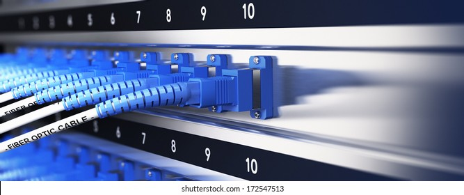 Close up of optical fiber optic telecommunication equipment and patchcords inside a network infrastructure. Blur effect with focus on one cable, blue tones.