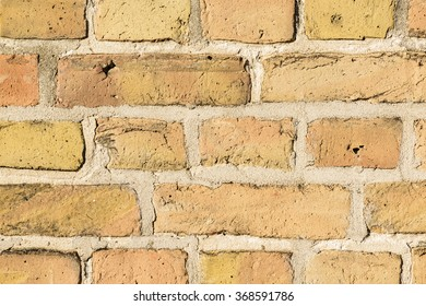 close up of orange brick wall texture background