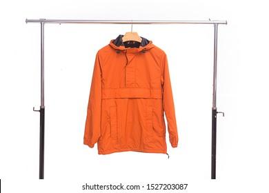 Close up Orange fashion Wind jacket on hanging
