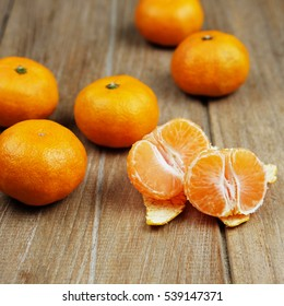 Close up of orange fruit and peeled orange style on wood background, selective focus and blank space concept.