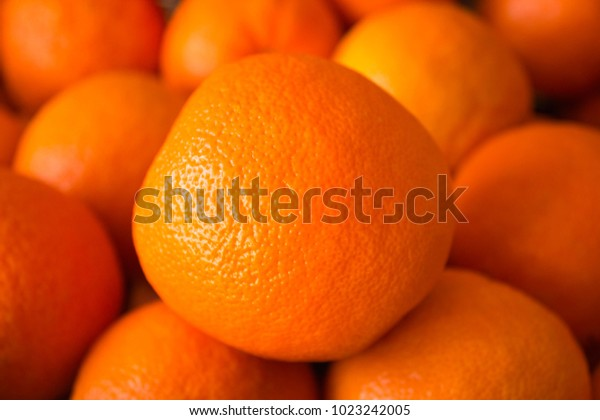 Close Up of Orange Fruit Standing Up on More Oranges