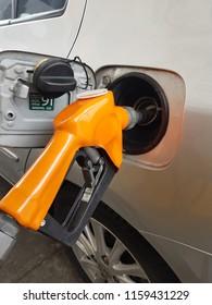 Close up of orange gas dispenser