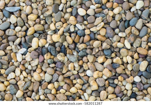 Close up of orange and grey pebble stone floor background texture