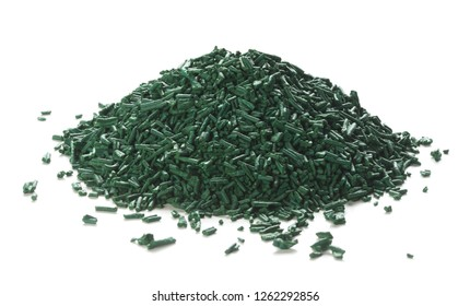 Close up of organic spirulina flakes heap over white background.