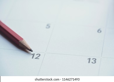 close up of organizer or calendar and red pencil, planning for business meeting or travel planning concept