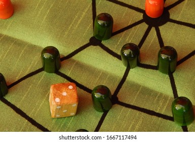 Close up of oriental or Indian or Asian dice based board game for children
