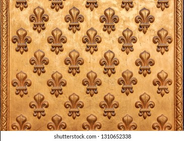 Close up of an ornate golden fleur de lis French royal pattern