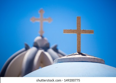 Close up from Orthodox Crosses on the beautiful Blue and white rooftops of a orthodox church,  There are many small churches all over Santorini. Greece, 2013.