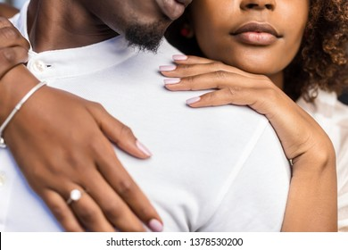 Close up outdoor protrait of black african american couple embracing each other