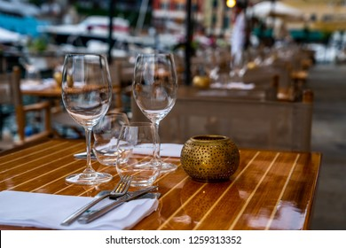 Close up of outdoor restaurant table in the evening. Restaurant chilling out classy lifestyle reserved concept. Restaurant interior. Table set restaurant.