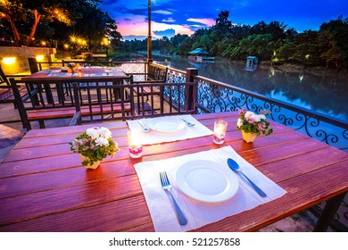 Close up of outdoor restaurant table in the evening.