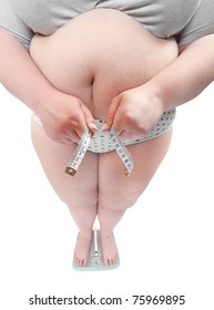 Close up of a overweight woman measure her waist belly by metre-stick on a weighing machine.