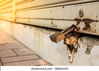 Close up pad lock at rolling steel Door