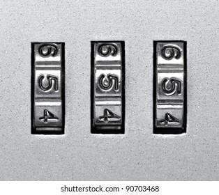 close up of  a padlock with code