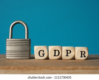 Close up of a padlock with wooden dices and the letters GDPR