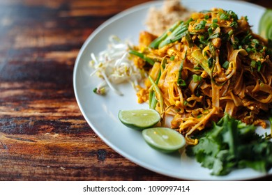 Close up Padthai noodle with smoke tofu and mixed vegetable - wheat germs,lime,cucumber,parsley.Healthy Vegetarian vegan menu