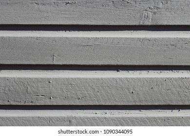 A close up of a painted wooden wall photographed in old town Porvoo, Finland. Beautifully colored wall photographed during a sunny to show it's beauty. Lovely colors and a bit rustic texture.