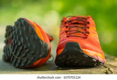 Close up of a pair of colorful trail running shoes. Shallow D.O.F.