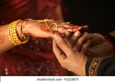 Close up of Pakistani couple's hands at a wedding, concept of marriage/partnership/commitment