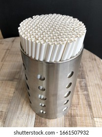 Close up of paper straws in metal can