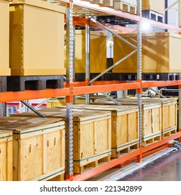Close up paper and wooden cargo box on steel shelf system in warehouse