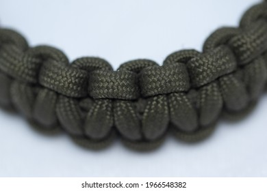 close up of a para cord bracelet on white background